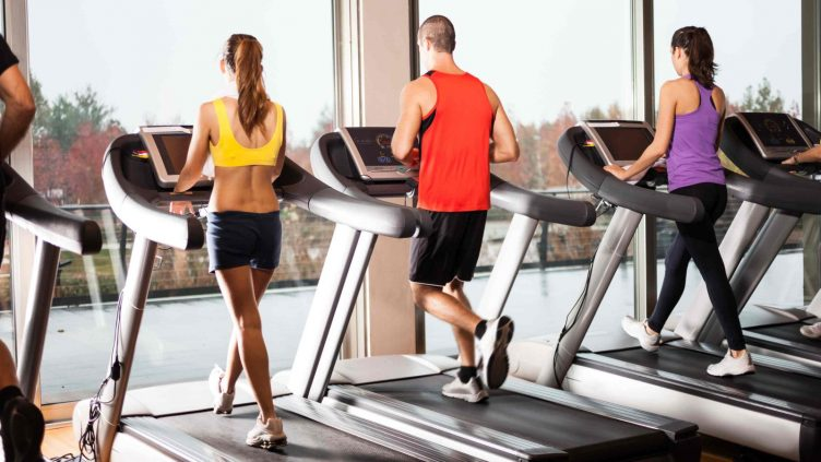 Treadmill Walkers in a Gym