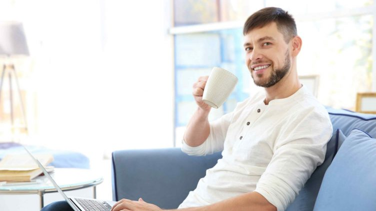 Man drinking his morning coffee as a habit. You can make walking a habit too.